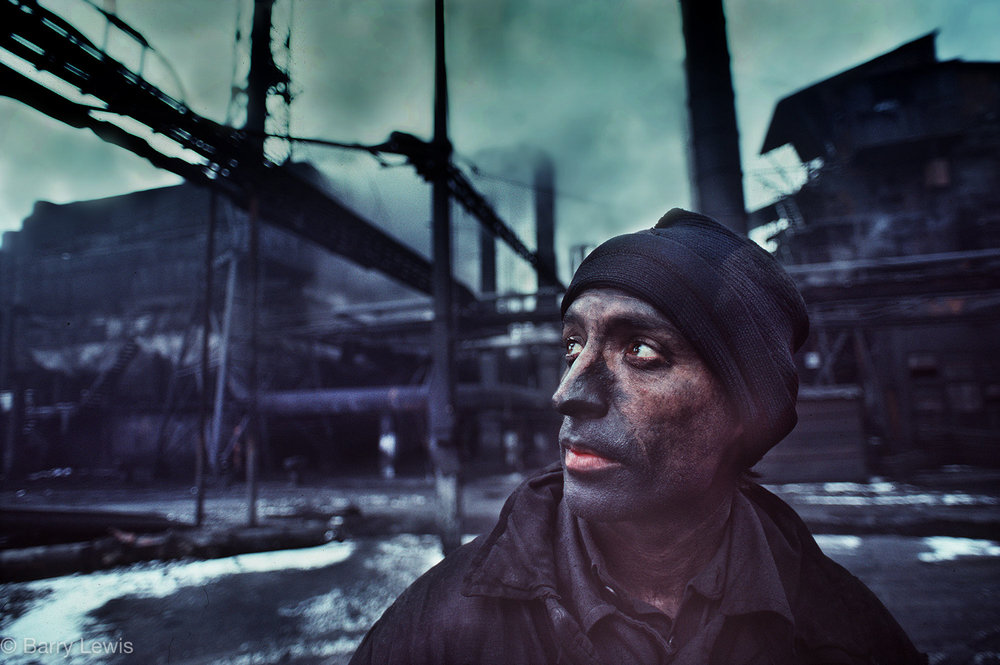 Worker in the carbosin plant producing lampblack for tyres in Copsa Mica, Romania, 1990. Years of neglect under the Ceaușescu regime created the most poluted region in the world.