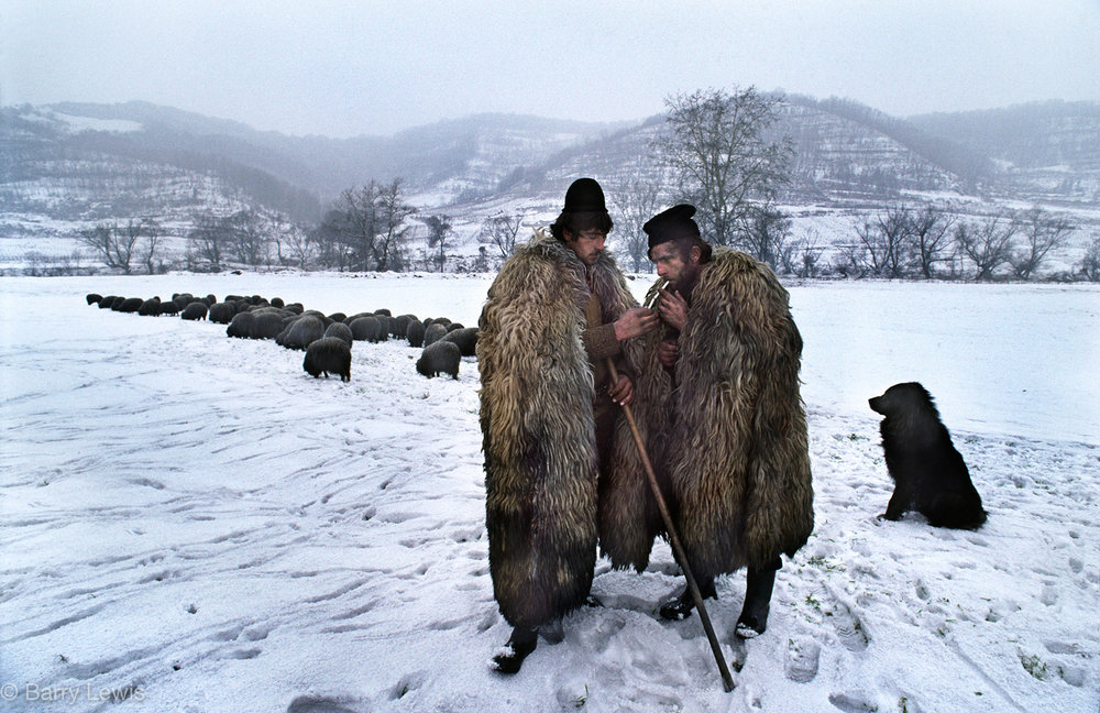 Shepherds sharing a cigarette near the carbosin plant in Copsa Mica, Romania, 1990. The sheep white coats are covered in soot. Years of neglect under the Ceaușescu regime created the most poluted region in the world.