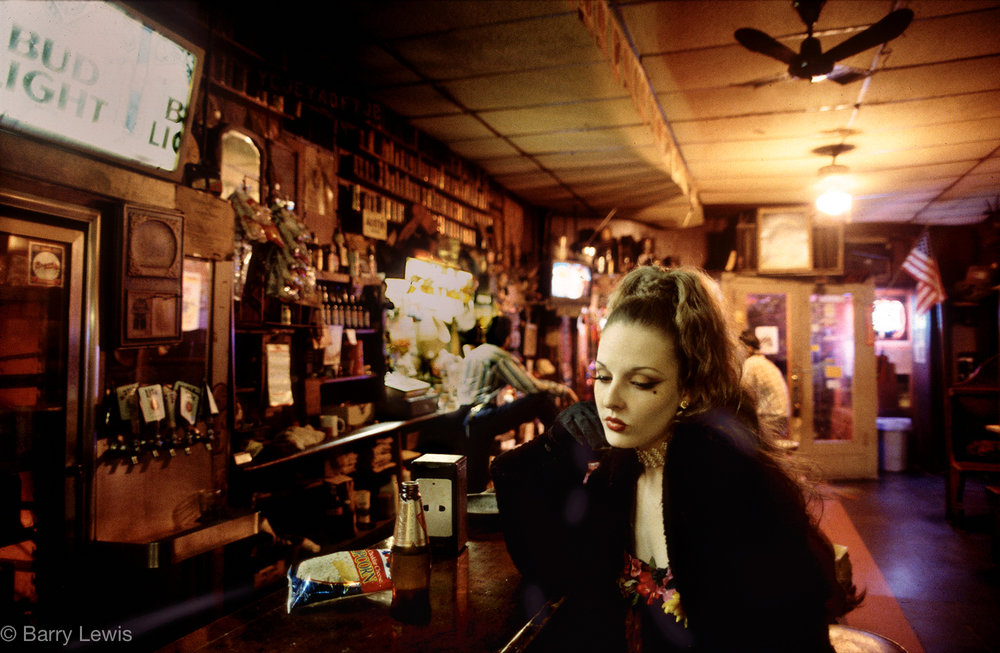 Girl drinking in the Starlight Bar, Little Five Points, Altlanta, USA. 1995
