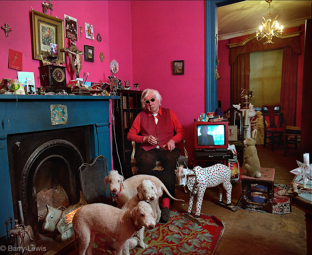 Artist Craigie Aitcheson in his London home and studio in 1999 with his adored Bedlington terriers.