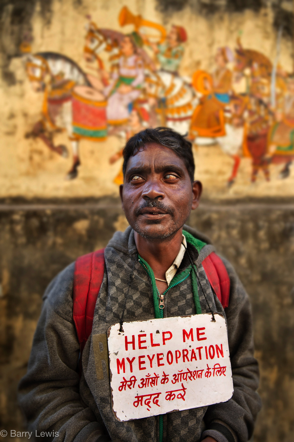Blind man, raising money for an operation, Udaipur, India, 2018