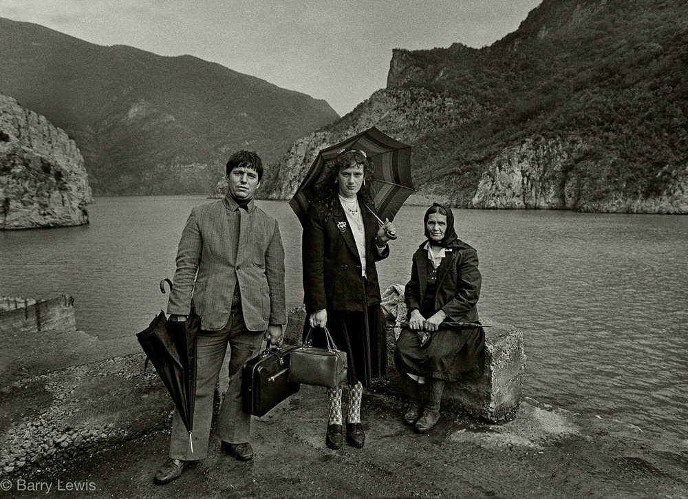 Albania family in their Sunday best waiting for the Koman Ferry to Bajram Curri, 1990. The ferry was the easiest way into the Highlands avoiding the bad roads. but cancellations and long delays were frequent.