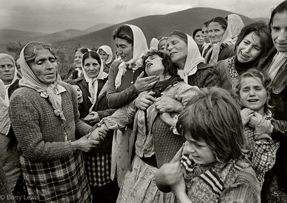 The Muslem funeral of 23 year old Baghkim Sinani in the mountain village of Kalimash, in the mountains of High Albania, 1991.