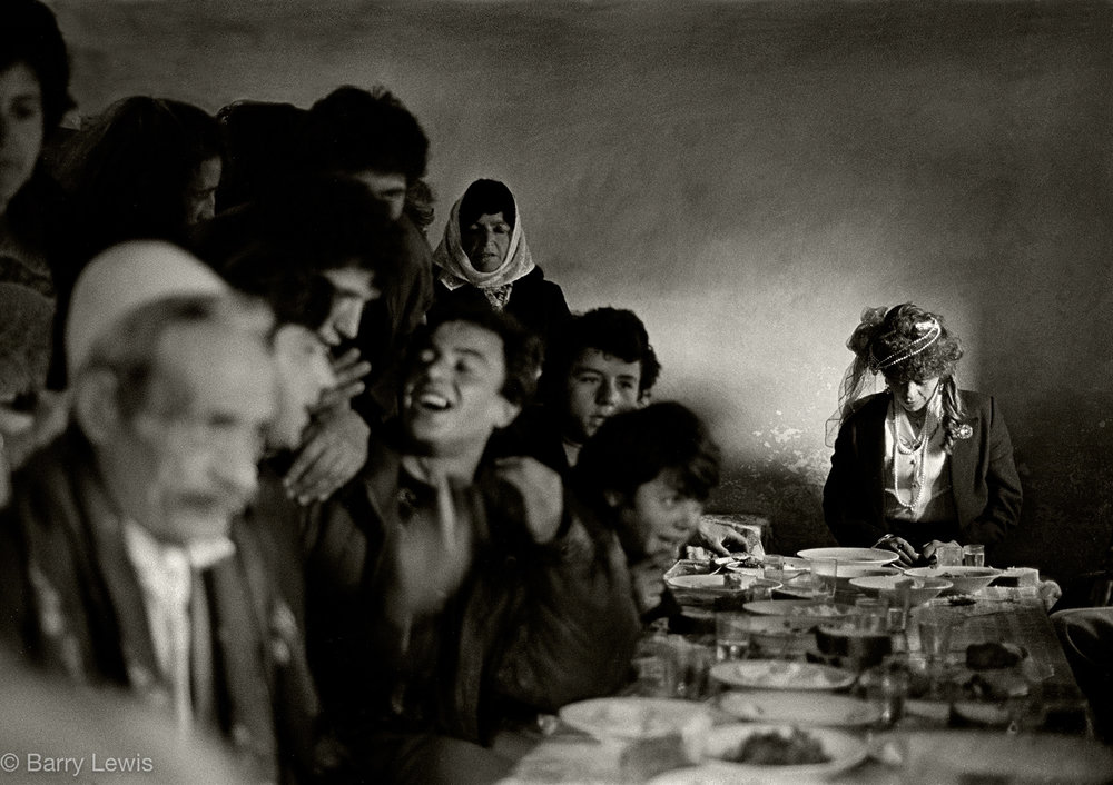Arranged wedding in the village of Boga in the mountains of Nothern Albania, 1991. For the bride it is an anxious time as she will shortly leave her home and village and move into the groom's family house where she will live for the rest of her life. The groom has just received a trousseau bullet, a symbolic gift from the bride's father, and to only be used in the event of her desertion or infidelity.