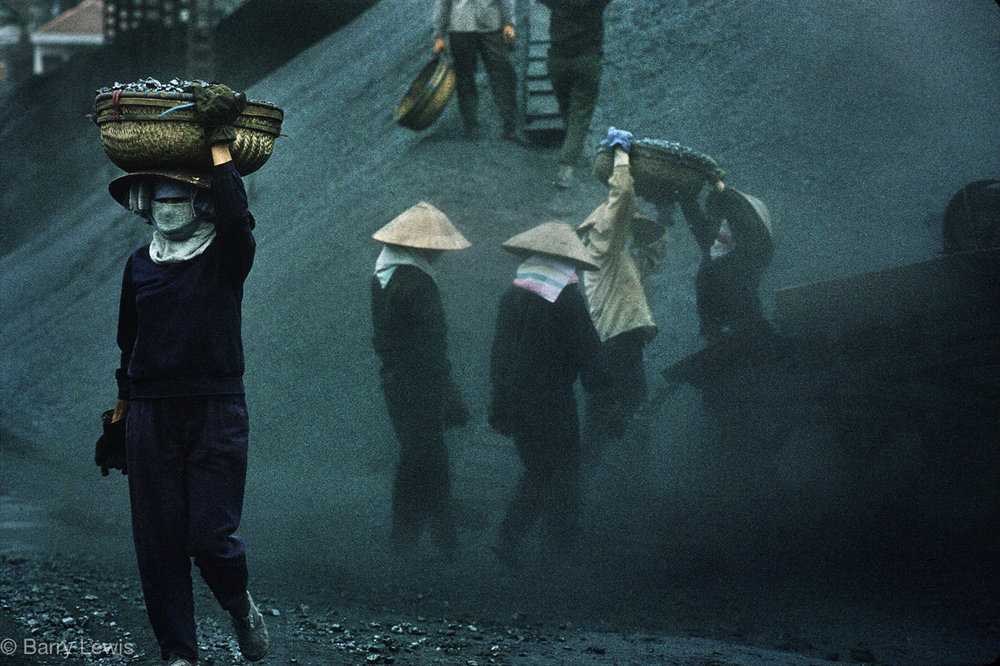 Women sorting coal in Vietnam's largest open cast mine, started by the French a century ago. Cam Pha 1993.
