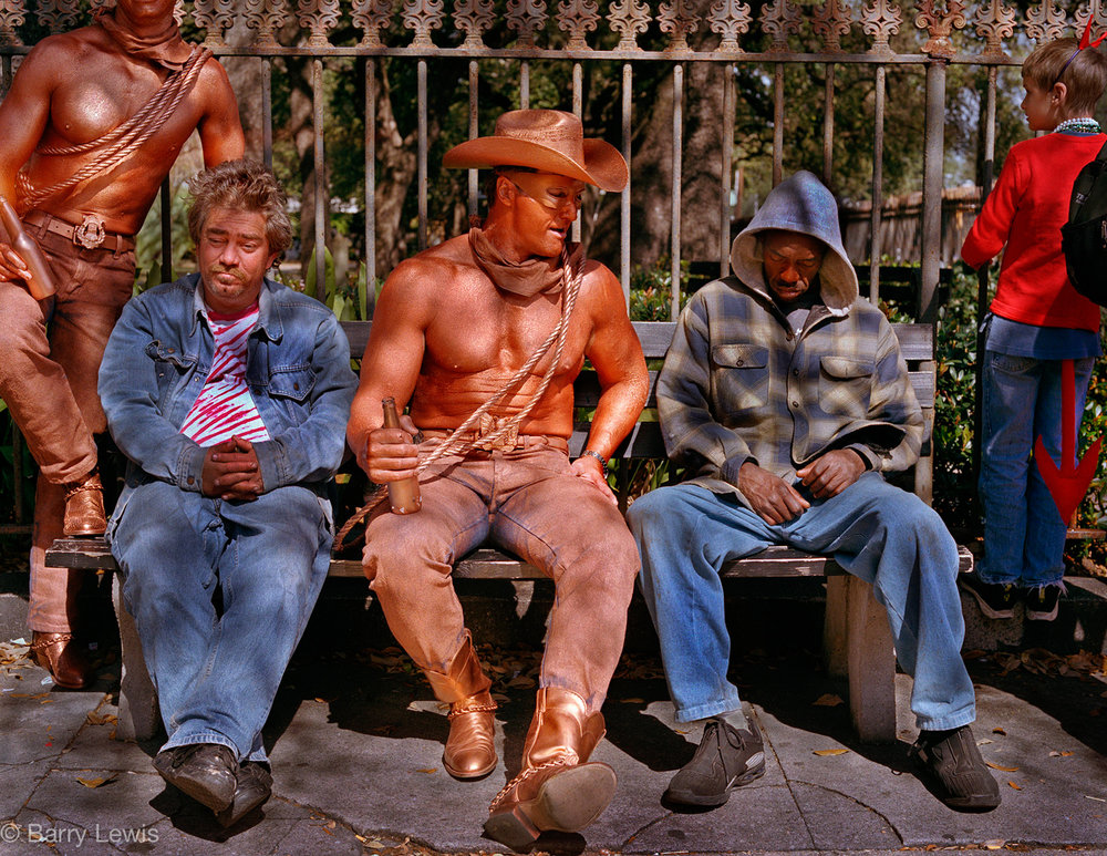 Revellers, some in costume, awaiting a parade, Mardi Gras, New Orleans, 2002