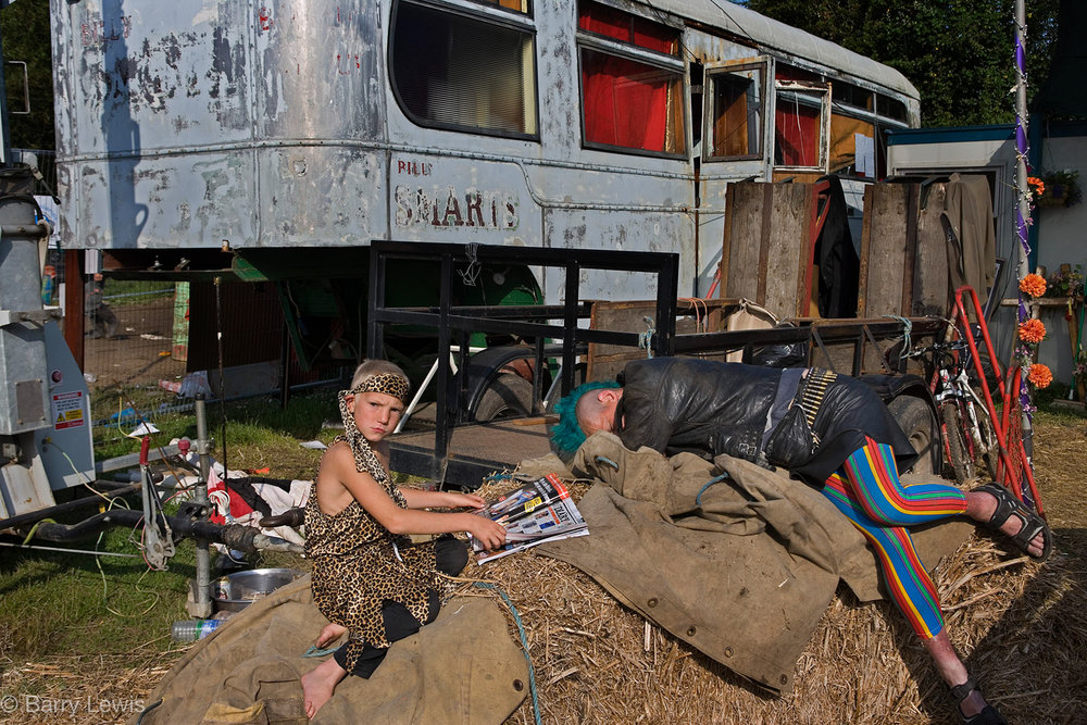 Boy waiting for his mum to wake up, Glastonbury Festival, 2005, Somerset, United Kingdom