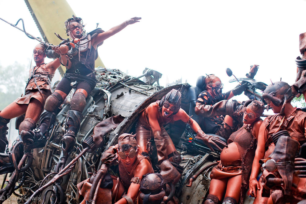 High Rise Rubber, a group of friends randomly performing on stilts during the Glastonbury Festival, 2009, Somerset, United Kingdom