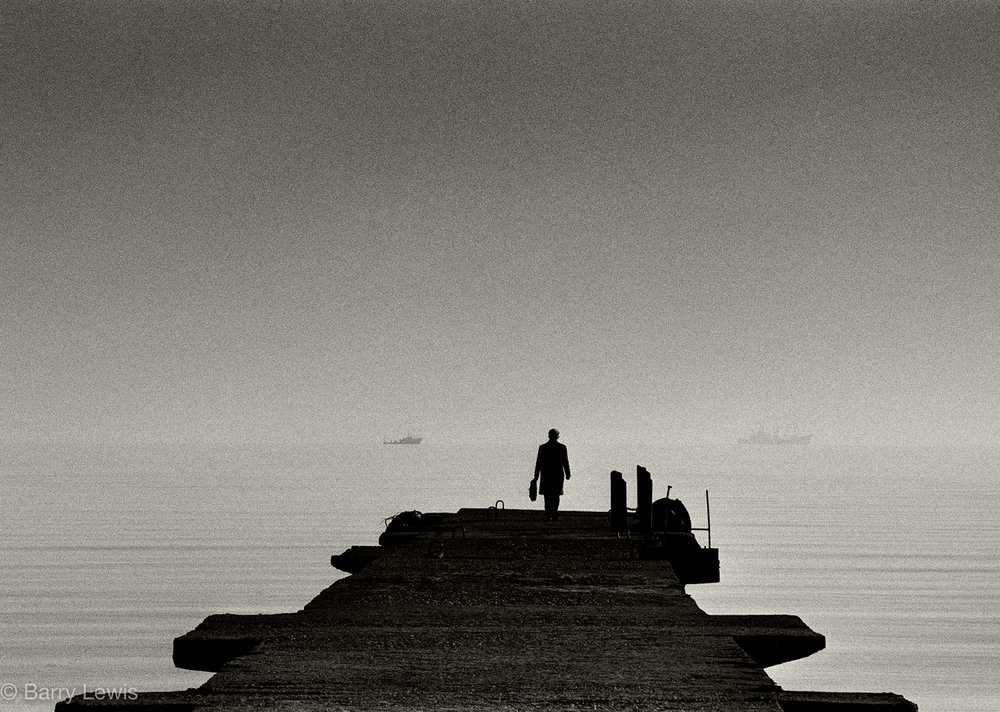 Durres, Albania, man looking out to sea, 1989.