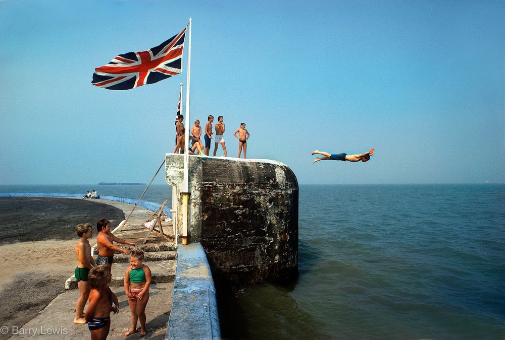 boy diving into sea