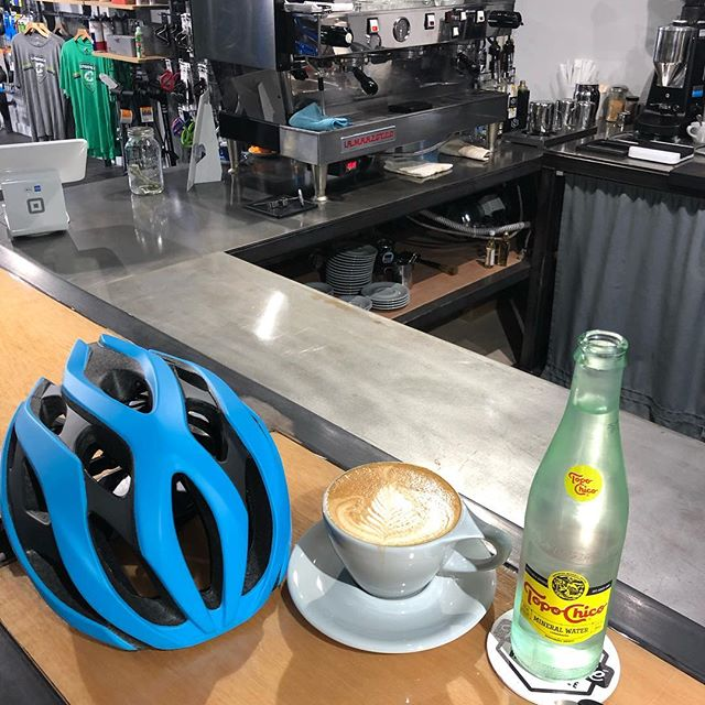 We're okay with helmets on the bar if you want to stop in for a mid-ride coffee break. @ray_cadence 's #latteart is on point today. 👌 . @cadencecyclerykeller @avocacoffeeroasters @giantbicyclesusa @topochicousa @lamarzocco . #bikesandcoffee #coffee #latte #cappuccino #cortado #espresso