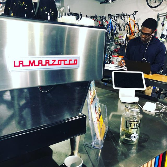 We tend to post a lot of pictures of coffee, latte art, bike accessories (i.e. stuff). The truth is it's the people that really matter. The relationships. The conversations. What we love most about BIKES + COFFEE is how they help facilitate those conversations and relationships. Pictured here is one of those things, our classic and beloved @lamarzocco espresso machine. More importantly, pictured here is one of those people. Louis has become a regular; can frequently be found studying and even sometimes working out in the cafe. Always brings a positive vibe and an intriguing story to tell. Good luck with that test, Louis! . #itsaboutthepeople @cadencecyclerykeller @avocacoffeeroasters #coffee #cafe #espresso #cortado #cappuccino #latte #coffeeshop #keepitinkeller #bikesandcoffee @giantbicyclesusa