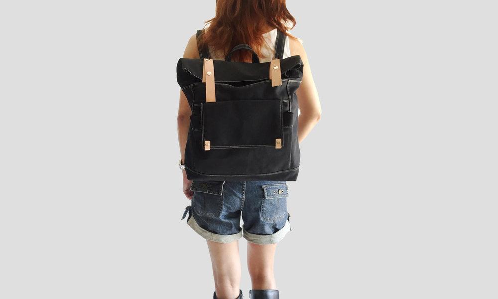 Model carrying Allison black backpack.jpg