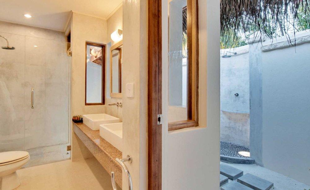 Maafushivaru-island-resort-beach-villa-bathroom.JPG