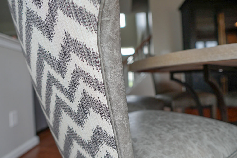 AFTER: Kitchen table chairs featuring a gray vinyl interior and chevron printed back