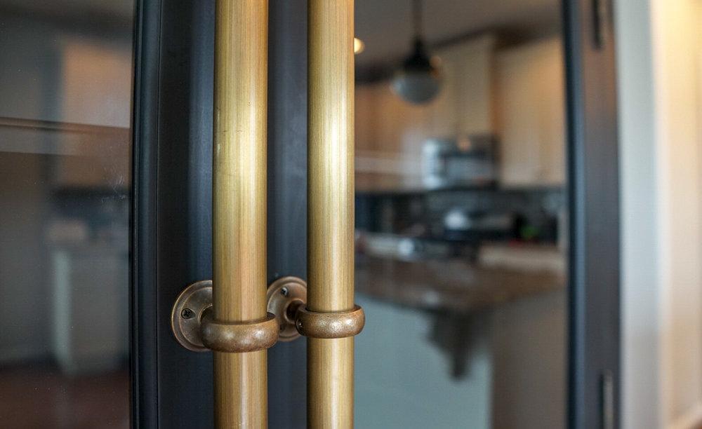 Black-Kitchen-Cabinet-Brass-Hardware.jpg