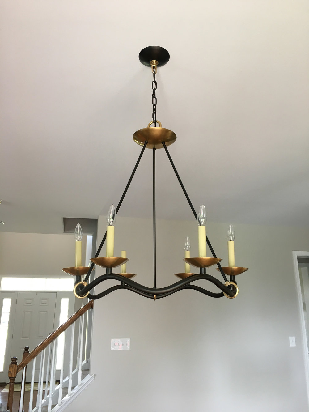 Iron and brass chandelier over the new eat-in kitchen table