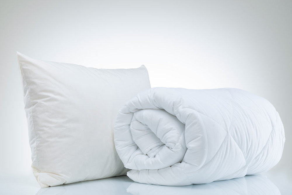 "Bed Basics - From pillows and duvets to mattress and pillow protectors, our lines of ""white goods"" are designed with a good night's sleep in mind. We offer comprehensive product lines from value-driven price points to luxury brand collections.  We also offer licensed and national brand lines made to order."