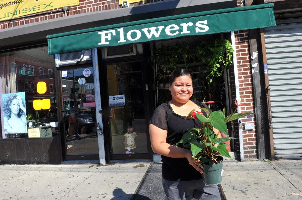 Grameen America member at her flower shop. Photo credit: Diane Bondareff
