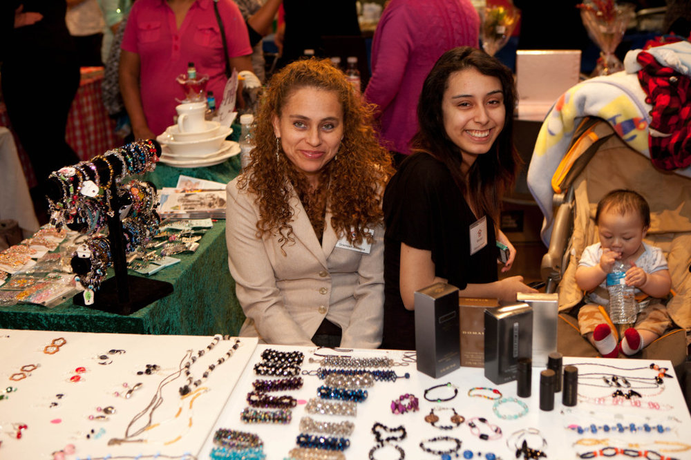 Grameen America members selling jewelry at a holiday market