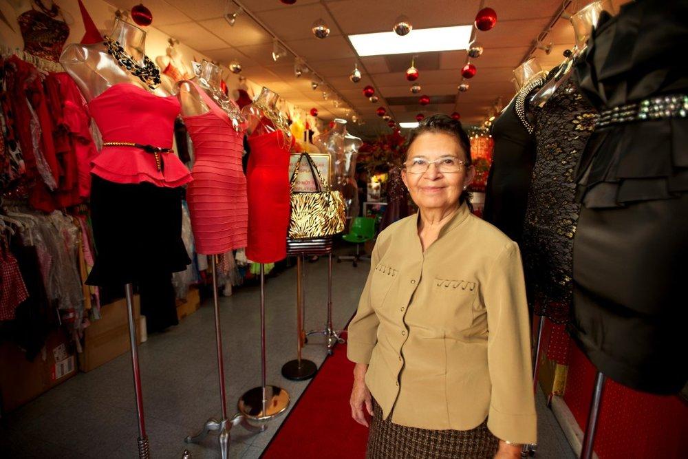 Grameen America member in her clothing store