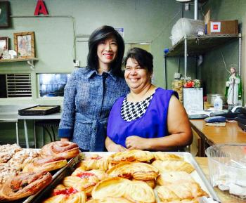 Grameen America President & CEO Andrea Jung with Bertha, a baker in Los Angeles who is growing her business thanks to a microloan from Grameen America.