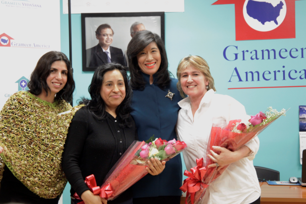 Grameen America President Andrea Jung celebrates the launch with members of Grameen America and Grameen VidaSana.