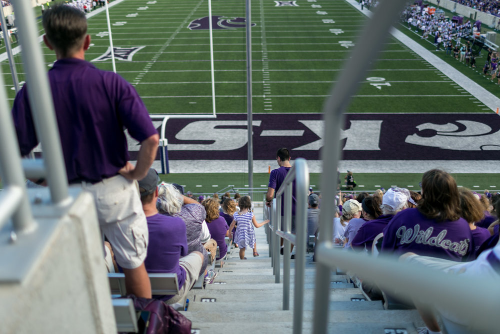 Captured by Best Documentary Family Photographer, Renee McDaniel of Renee McDaniel Photography in Manhattan Kansas. Photographed at Bill Snyder Family Stadium, Kansas State University, Manhattan Kansas.