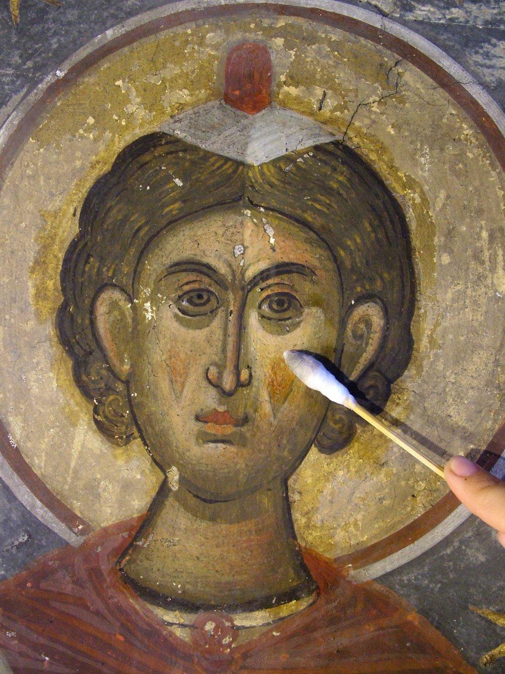Detail during cleaning, Karanlık Kilise, Göreme Valley, Turkey