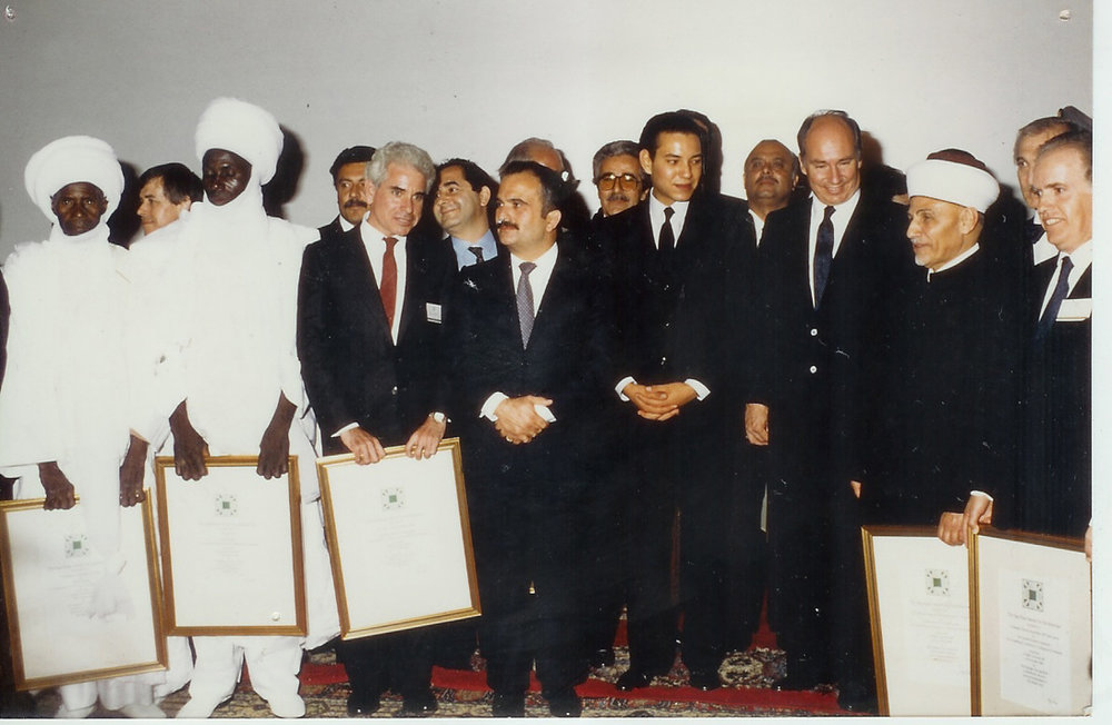 1986, Marakesh, Morocco. Presentation of the AGA KHAN Award for Architure for the restoration of the fire damaged painted dome of the Al Aqsa Mosque Jerusalem. Paul Schwartzbaum, third from the left, with Prince Hassan bin Talal of Jordan, King Mohammed VI of Morocco, and the Aga Khan. -