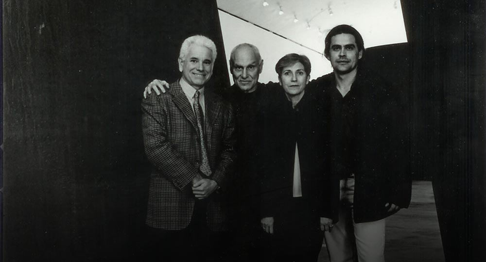 With Carmen Gimenez, Richard Serra, and Siro De Boni, during the installation of Richard Serra's Torqued Ellipse. Guggenheim museum, Bilbao, 2003.