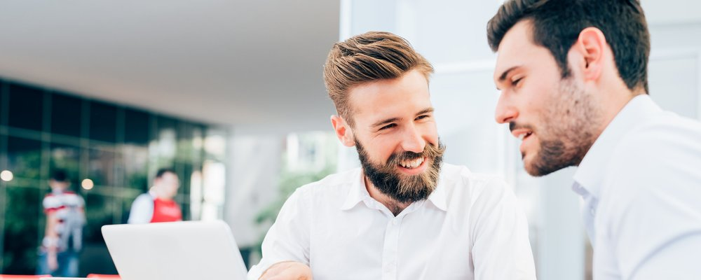 graphicstock-two-young-bearded-caucasian-modern-business-man-sitting-in-a-bar-using-laptop-looking-each-other-smiling-and-chatting-business-work-technology-concept_H6NTVglqyb.jpg