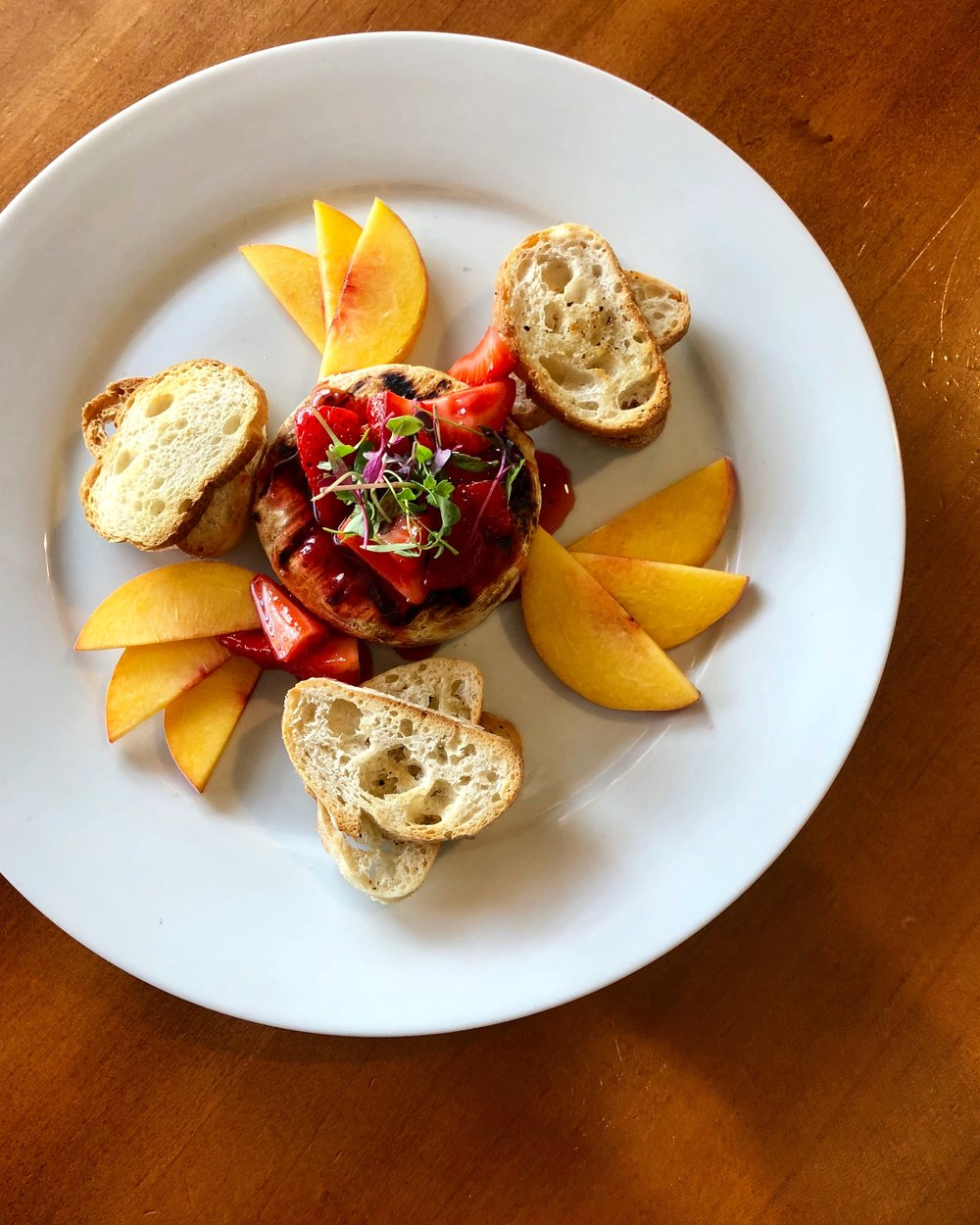 Grilled Baby Brie with SC Peaches, Preserved Strawberries, Toasted Crostini