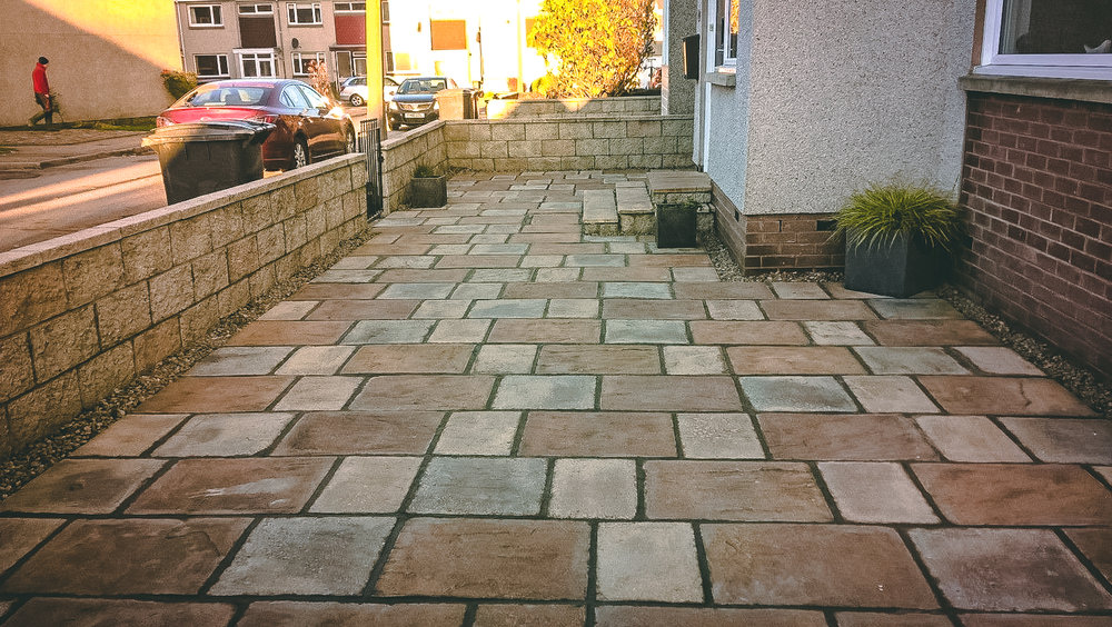 Re-pointing and rpessure washing patio area