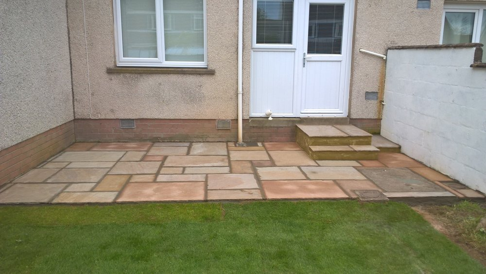New patio, steps and lawn