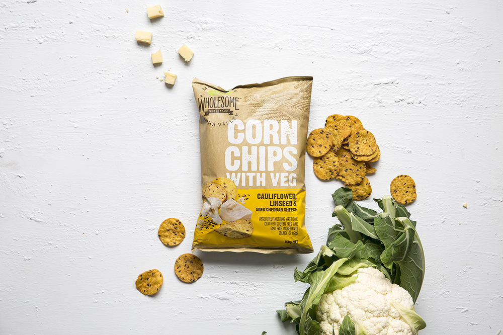 Corn Chips with Veg: Cauliflower, Linseed and Aged Cheddar Cheese - Our Corn Chips with Veg are a gluten free and GMO free snack made from Australian corn using traditional methods. With added cauliflower, they are irresistibly moreish, delicately crunchy and perfectly seasoned with aged cheddar cheese. Available in a 150g pack.View ingredients