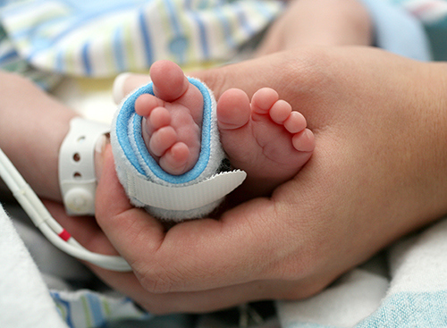 Infant feet with CCHD monitor