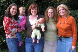 Amy, Dexter, big sister Lucy and their midwives Christy, Susi and Karen