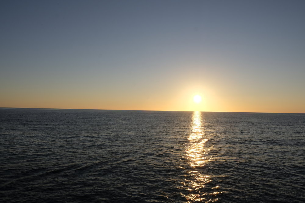 Sunset view from the ferry, on the way from Malta to Gozo  © Paul Wheatley