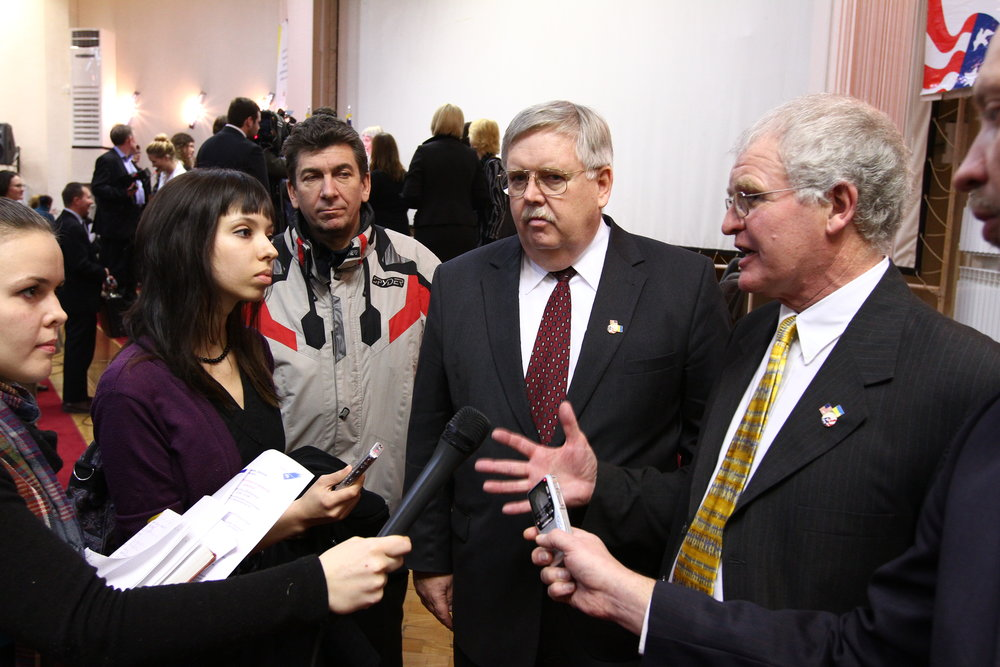 Dr. Teschner (right) with US Ambassador (center) John Tefft in Ukraine.