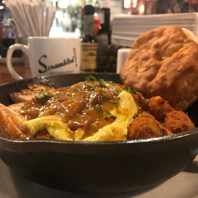 """Have you tried our latest special? If not, what are you waiting for?  Chicken """"poutine"""" skillet  A skillet made with grilled chicken, fried cheese curds, home made red eye gravy, two eggs made to specification, and your choice of hashbrowns or grits, as well as your choice of bread! #GetScrambled"""