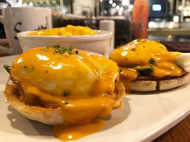 Hungry for breakfast, brunch or lunch? We serve it all at Scrambled! This week we have a  Salami Benedict! A Benedict made with salami, spinach, poached eggs, on an English muffin, topped with tomato hollandaise and with your choice of hash browns or grits! #getscrambled