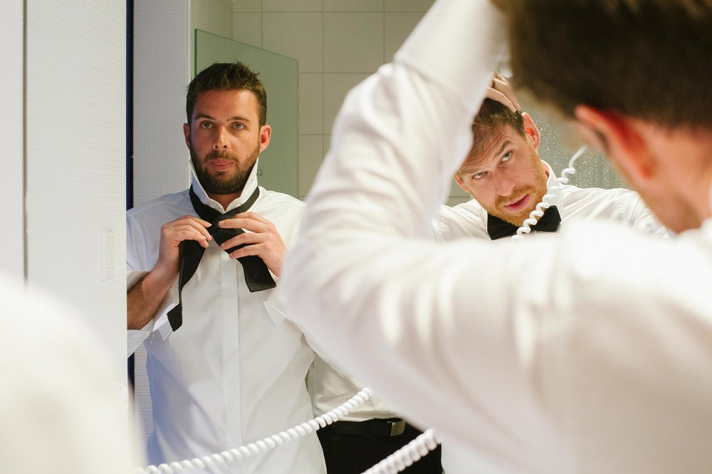 groom-getting-ready-drying-hair-wedding-ascona-lake-maggiore-switzerland.jpg