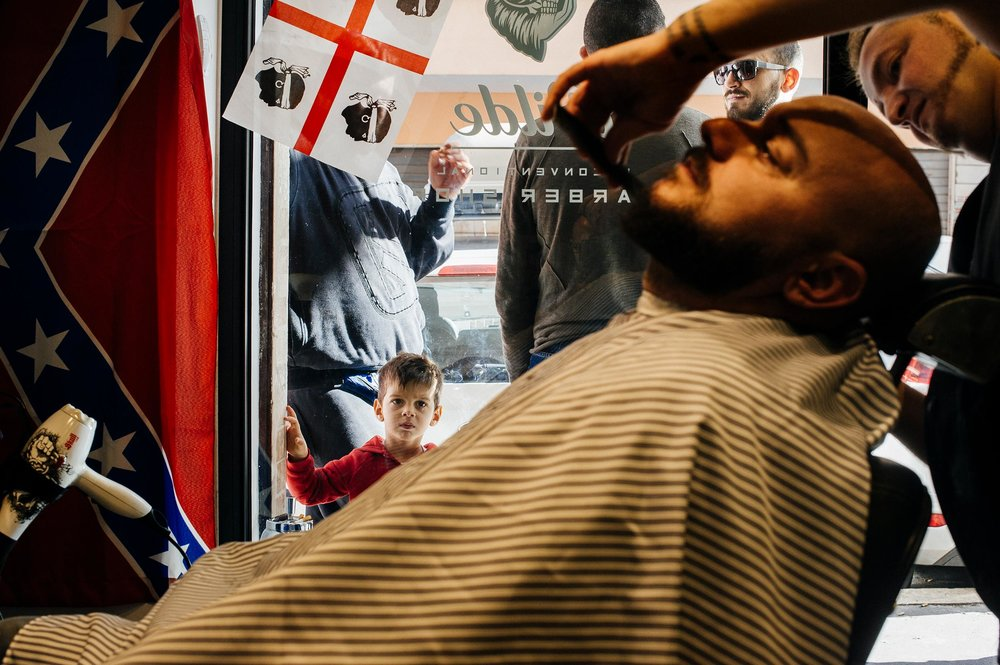 kid-watches-groom-in-the-barbershop.jpg