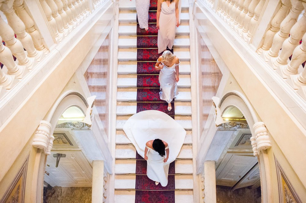 wedding-in-lake-como-bride-and-bridal-party-coming-down-the-steps-symmetry-wes-anderson.jpg
