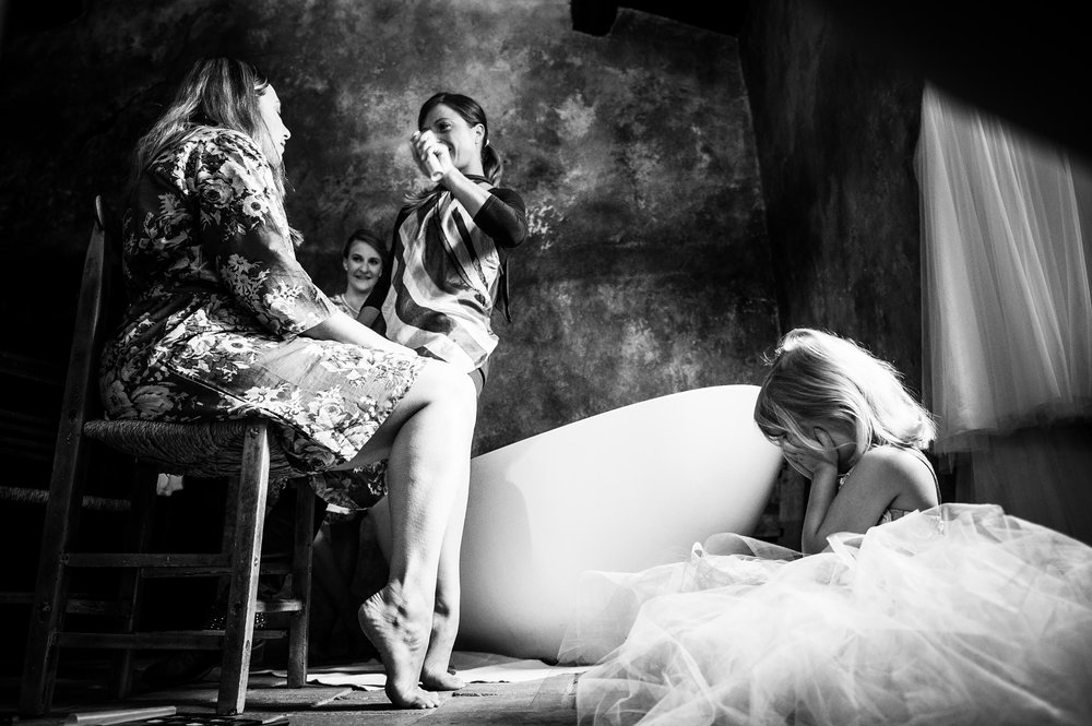 girl-puts-her-hands-on-her-face-while-mom-get-sprayed-during-getting-ready-black-and-white-wedding-photography.jpg