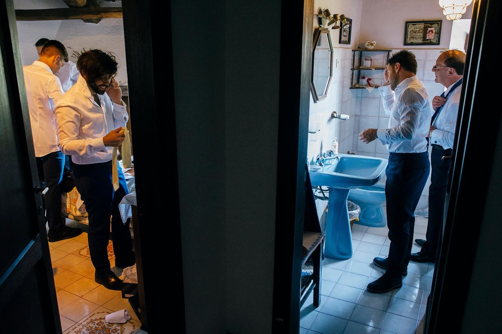 groom-his-dad-and-other-men-getting-ready-before-wedding-in-italy.jpg