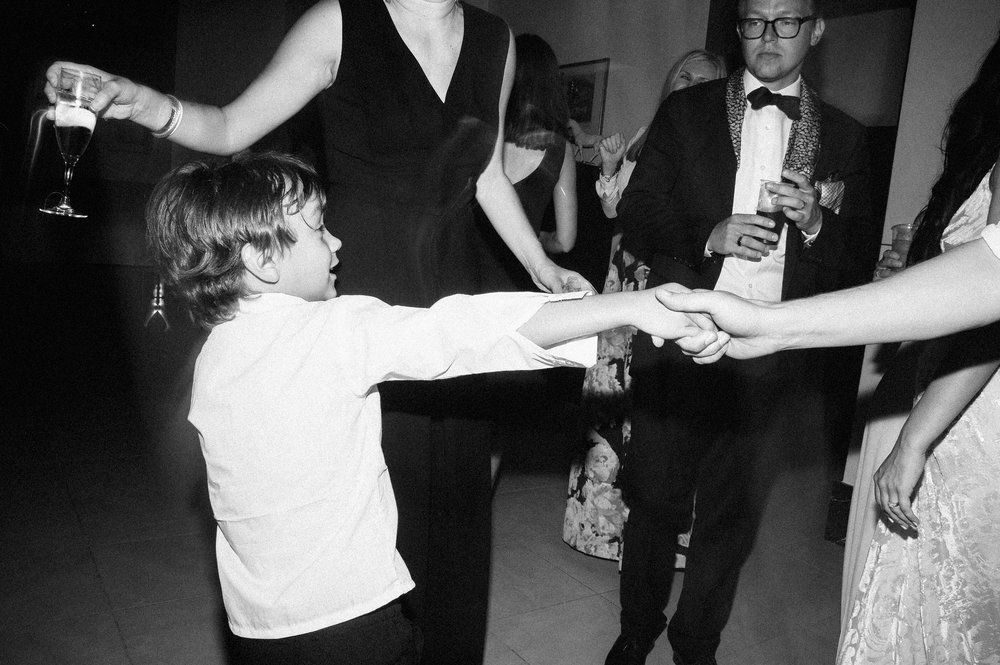 kid-dancing-during-reception-black-and-white-60s-style-black-and-white-wedding-photography.jpg