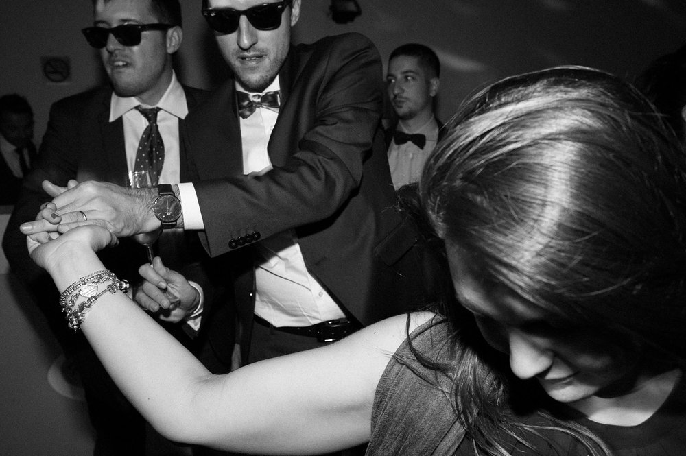 reception-dancing-in-black-and-white-by-the-guests-black-and-white-wedding-photography.jpg