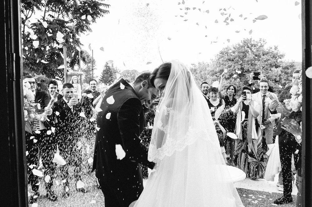 wedding-in-southern-italy-confetti-rice-outside-the-church-black-and-white-wedding-photography.jpg